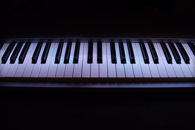 a digital piano in a dimly lit area